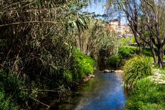 Rec Comtal. The Rec Comtal is a channel constructed in the middle ages to take water to Barcelona. Nowadays there remains a part of the tracing, which waters the Royalty Free Stock Image