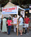 Recall Snyder booth at Ann Arbor Art Fair. ANN ARBOR, MI - JULY 22: Supporters of an effort to recall Michigan Governor Rick Snyder staff a booth to gather Stock Photo