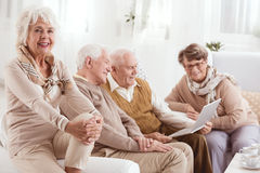 Recalling old times. Group of elderly people recalling old times together stock photos