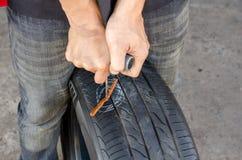 Recap deflating vehicle tyre Royalty Free Stock Photography
