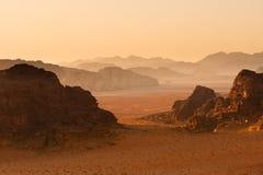 Receding mountains in sunset, Wadi. Mountains in sunset receding into background. Wadi Rum desert, Jordan royalty free stock photo