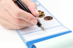 Receipt Book Fountain Pen and coin Stock Images