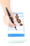 Receipt Book Fountain Pen and coin Royalty Free Stock Photography