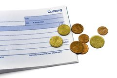 Receipt with euro coins and ball-pen Royalty Free Stock Images