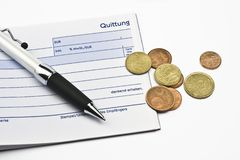 Receipt with euro coins and ball-pen Stock Photo