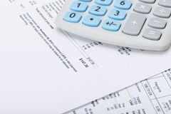 Receipt next to calculator Royalty Free Stock Image