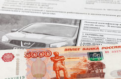 Receipt for payment of a fine for violation of traffic rules and money. SAMARA, RUSSIA - OCTOBER 9, 2014: Receipt for payment of a fine for violation of traffic Stock Images