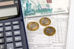 Receipt for payment of utilities, calculator and Russian money. Receipt for payment of utilities, calculator, Russian money and notepad stock image