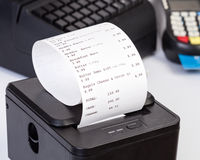 Receipt Printer with paper shopping bill. Royalty Free Stock Images