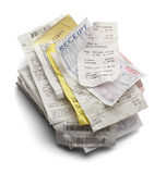 Receipt Stack. Pile of Varioous Receipts Isolated on White Background Royalty Free Stock Photo