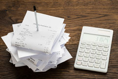 Receipts With Calculator On Table Royalty Free Stock Image