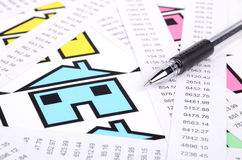 Receipts and house with pen Royalty Free Stock Photo
