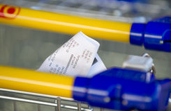 Receipts on a shopping cart Stock Photos