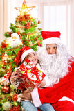 Receive gift from Santa Claus Stock Photos
