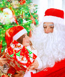 Receive present from Santa Claus Stock Photography