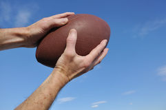 Receiver Catching an American Football Pass Royalty Free Stock Images