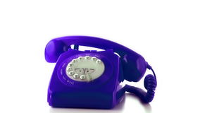 Receiver falling on purple dial phone stock footage