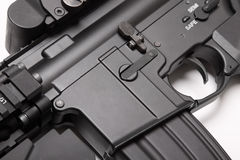 Receiver of US Army M4A1  assault rifle close-up. Modern weapon series. US Army M4A1 assault rifle receiver close-up. Object on white backgound Royalty Free Stock Photo