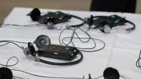 Receivers With Headphones For Translation. High tech modern audio devices stock video footage