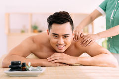 Receiving back massage Royalty Free Stock Photography