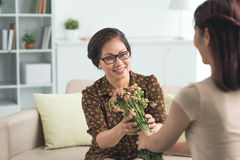 Receiving bouquet of flowers Royalty Free Stock Photo