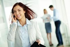 Receiving business phone call Stock Photo