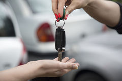 Receiving car key of a new car. Royalty Free Stock Photo