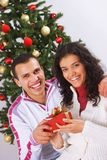 Receiving christmas present Royalty Free Stock Images