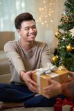 Receiving Christmas present royalty free stock photos