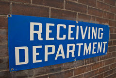 Receiving Department. A sign on the loading dock of an old wearhouse Royalty Free Stock Photo