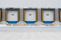 Receiving dock doors. Three colourful receiving dock doors used in shipping and receiving in the trucking industry stock photography