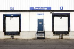 Receiving docks. Recieving docks on the outside of a white warehouse Royalty Free Stock Photo