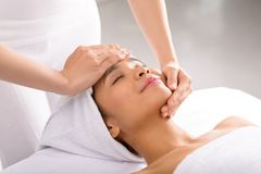 Receiving facial massage Royalty Free Stock Photo