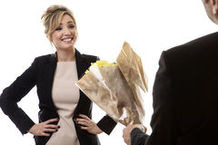 Receiving Flowers Royalty Free Stock Photography