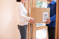Receiving large parcel Royalty Free Stock Images
