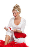 Receiving a love letter. Pretty blond girl looking excited by receiving a love letter for valentine Royalty Free Stock Photo