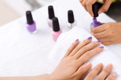 Receiving manicure Stock Images