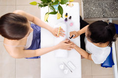 Receiving manicure Stock Image