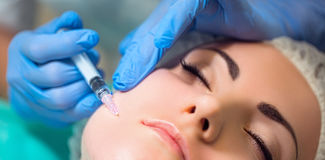 Receiving mesotherapy procedure, cosmetology. Beautician doing p Royalty Free Stock Images