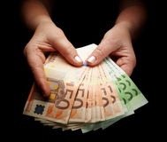 Receiving money. Female hands holding european paper currency Stock Image