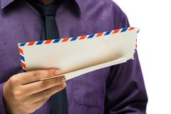 Receiving old mail. Businessman reading address on old envelope Stock Image