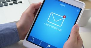 Receiving one new email message on digital tablet stock video