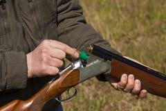 Receiving open gun ammunition Royalty Free Stock Photos