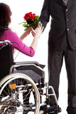 Receiving roses on wheelchair Stock Images