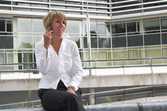 Receiving some good news. Businesswoman on the phone stock photos