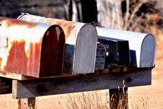 Receiving Time. Old Mailboxes in an abandon ghost town, waiting for another day of mail to deliever Stock Photos