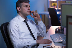 Receiving an urgent call. Shot of a focused office worker talking over the phone Royalty Free Stock Photography
