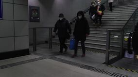 18.02.2020 Shanghai/China- People with masks go to metro station