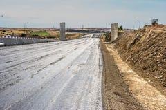 Recente weg om een eerste laag te asfalteren stock foto's