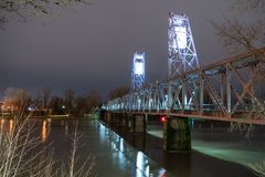 Lighted Pedestrian Bridge Crossing Willamette River Riverfront P. A recently finished bridge deck allows pedestrians to venture out over the Willamette River in Stock Photography